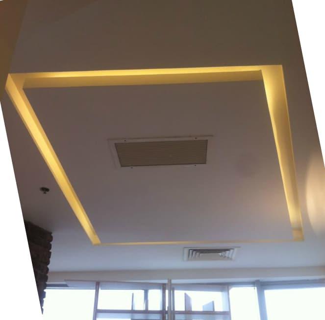 עבודת גבס בשילוב תאורה נסתרת והנמכת תקרה